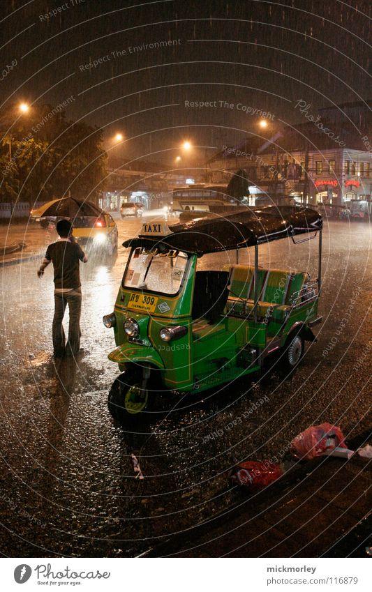 bangkok monsoon Monsoon Thailand Bangkok Gale Taxi Stream Umbrella Torrents of water Town Night Ignore Extreme Transport Light Artificial light Trash Dark Black
