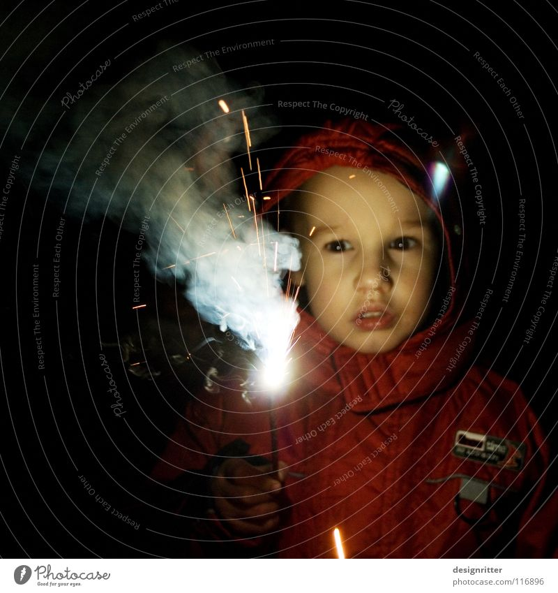 Child Boy (child) Playing Blaze Dangerous Threat New Year's Eve Discover Passion Brave Firecracker Enthusiasm Fire department Sparkler Fire prevention Disaster