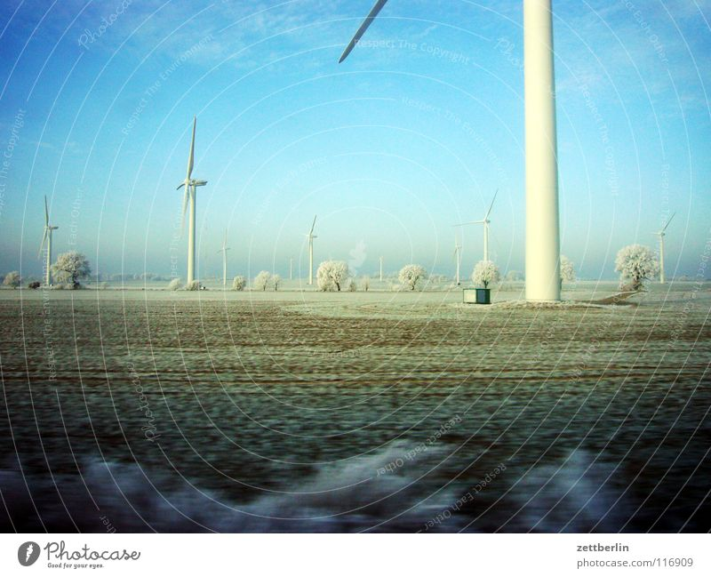 Sky Tree Winter Vacation & Travel Lamp Snow Landscape Field Wind Railroad Energy industry Driving Bushes Wind energy plant Hoar frost Passage