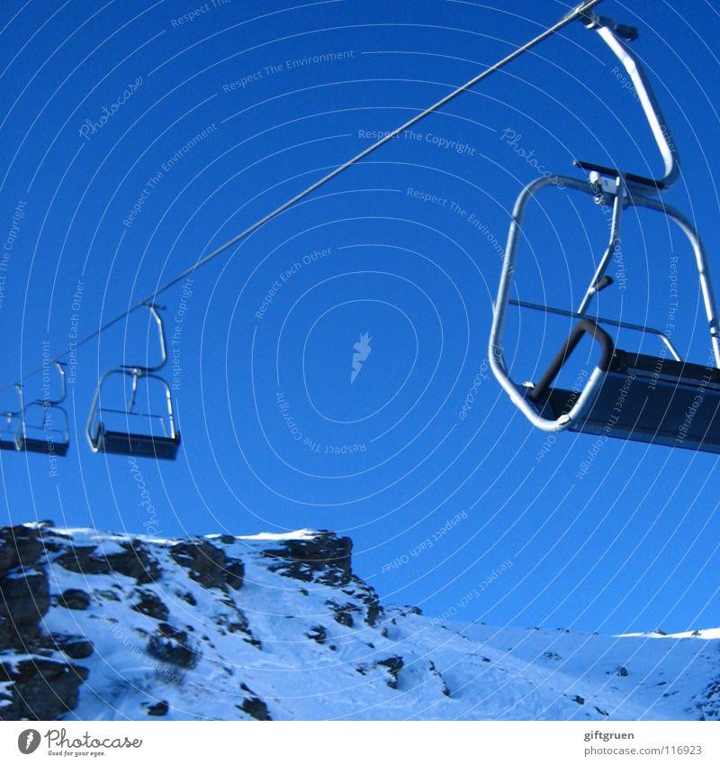 Sky Blue Winter Mountain Snow Sports Playing Leisure and hobbies Tourism Beautiful weather Rope Peak Skis Upward Downward Austria