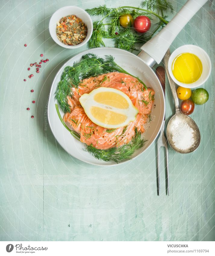 Fry salmon fillet with dill, lemon, oil and tomatoes Food Fish Vegetable Herbs and spices Cooking oil Nutrition Lunch Dinner Organic produce Vegetarian diet