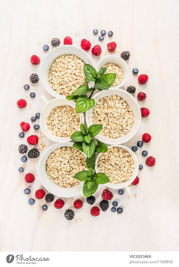 Oatmeal, mint and berries - family breakfast. Food Fruit Grain Herbs and spices Nutrition Breakfast Organic produce Vegetarian diet Diet Bowl Style Design