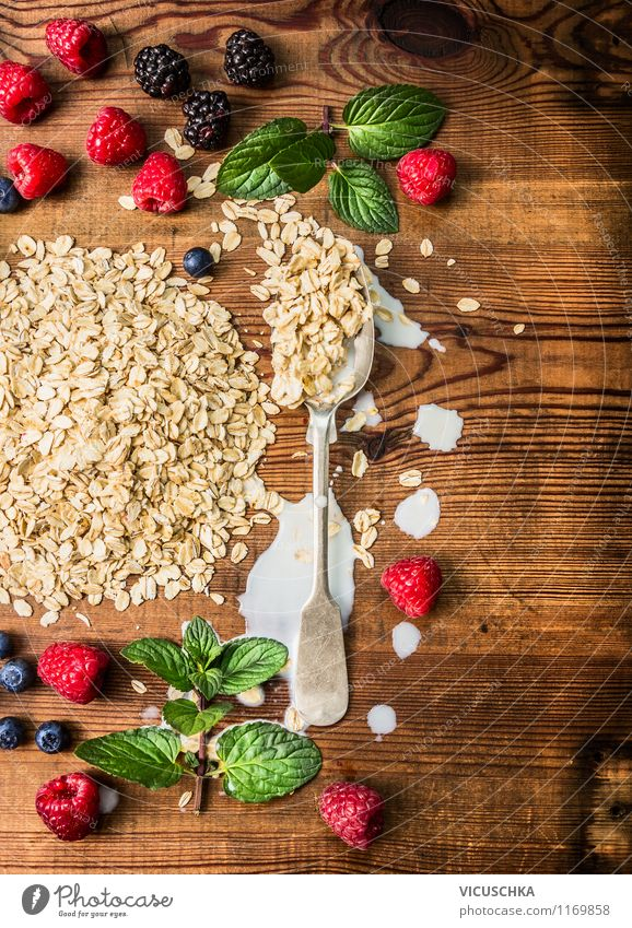 Prepare breakfast with oatmeal and berries Food Fruit Grain Nutrition Breakfast Organic produce Vegetarian diet Diet Milk Spoon Style Design Healthy Eating Life