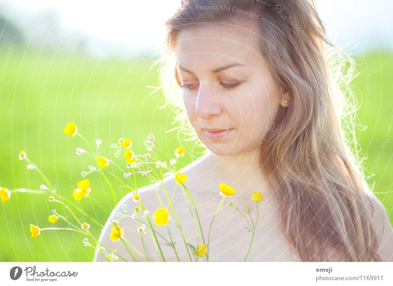 buttercups Feminine Young woman Youth (Young adults) Face 1 Human being 18 - 30 years Adults Plant Spring Summer Beautiful weather Flower Natural Yellow Green
