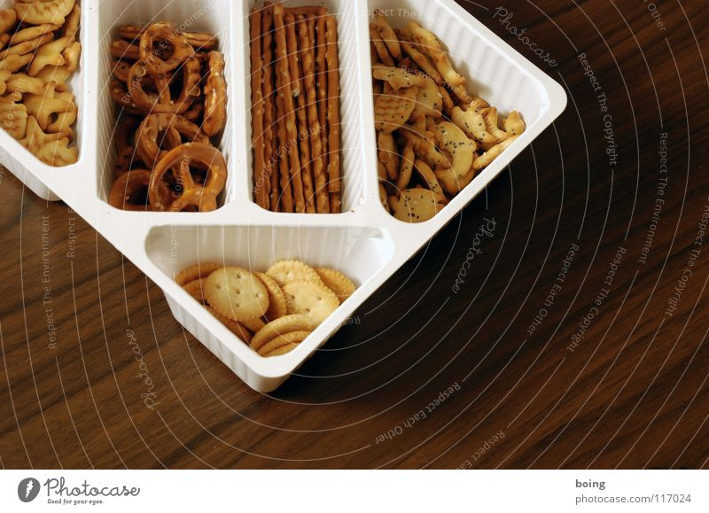 solid food F Savory snacks Salt stick Packing material Food photograph Section of image Partially visible Close-up Neutral Background Salty Pretzel
