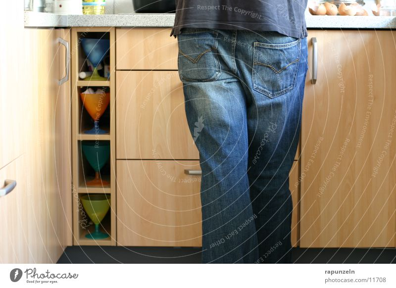 Even the man is Man Masculine Kitchen Cooking Nutrition Cupboard eugen Food Emancipation Legs Hind quarters Jeans Detail