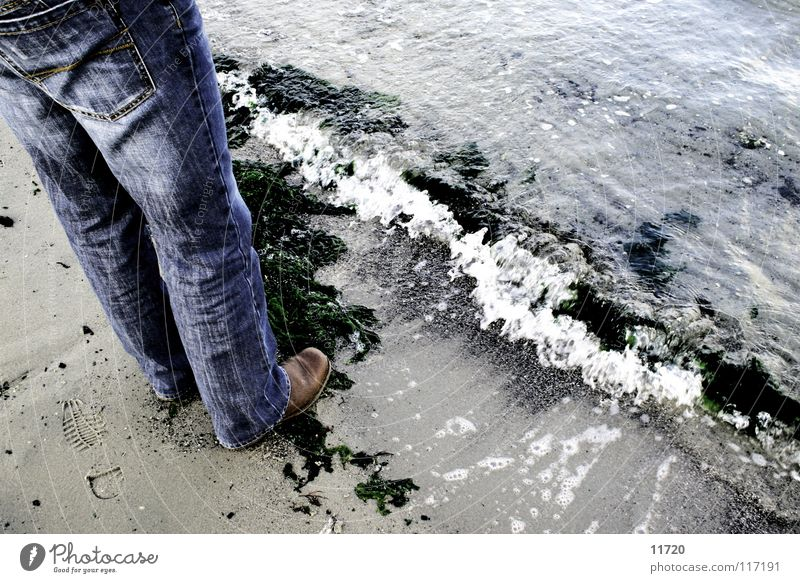 Day at the sea Ocean Waves Foam Algae Low tide Current Boots Netherlands Lake Grain of sand Sand Legs High tide Jeans