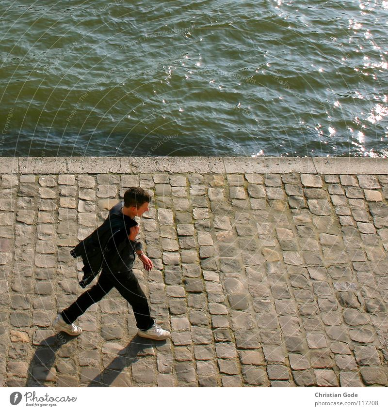 Walking France Paris Seine Louvre Man French Going To go for a walk Black Green White Footwear Bird's-eye view Water River cobblestone pavement Blue Shadow