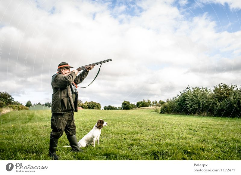 Hunter shooting a rifle Dog Human being Nature Man Landscape Adults Autumn Senior citizen Meadow Sports Playing Lifestyle Masculine Leisure and hobbies Wild Action