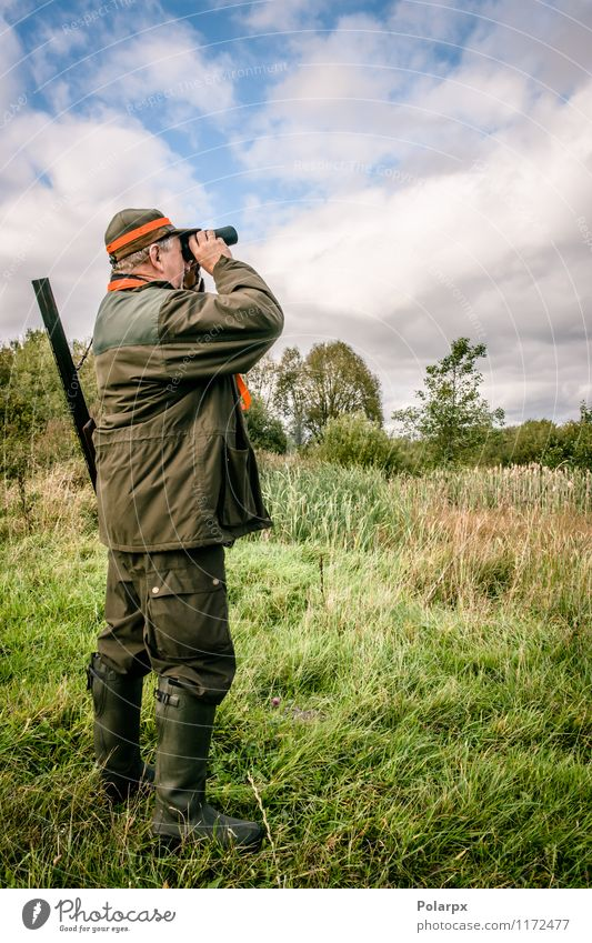 Hunter looking in binculars Dog Human being Nature Man Green Relaxation Landscape Adults Autumn Sports Leisure and hobbies Wild Action Stand Observe Seasons
