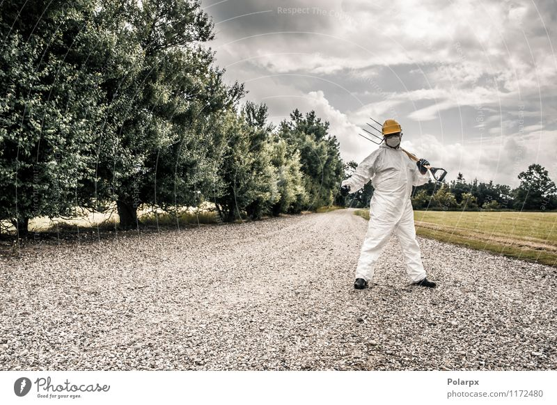 Worker standing on a road Fork Science & Research Work and employment Profession Industry Tool Human being Man Adults Nature Clouds Grass Street Suit Gloves