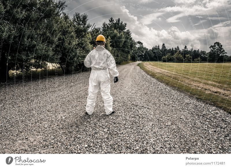 Worker looking down a road Human being Nature Man Clouds Adults Yellow Street Grass Work and employment Fear Stand Dangerous Industry Safety Profession Strong