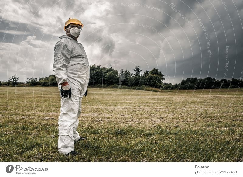 Worker in cloudy weather Science & Research Work and employment Profession Industry Human being Man Adults Nature Clouds Grass Suit Gloves Stand Strong Yellow