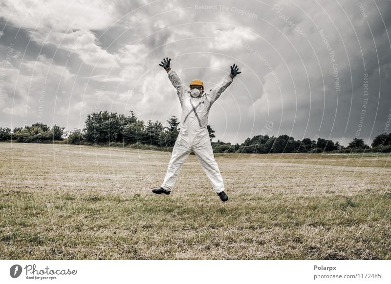 Chemist jumping in the air Human being Nature Man Clouds Adults Yellow Senior citizen Grass Happy Jump Work and employment Fear 60 years and older 45 - 60 years Dangerous Industry