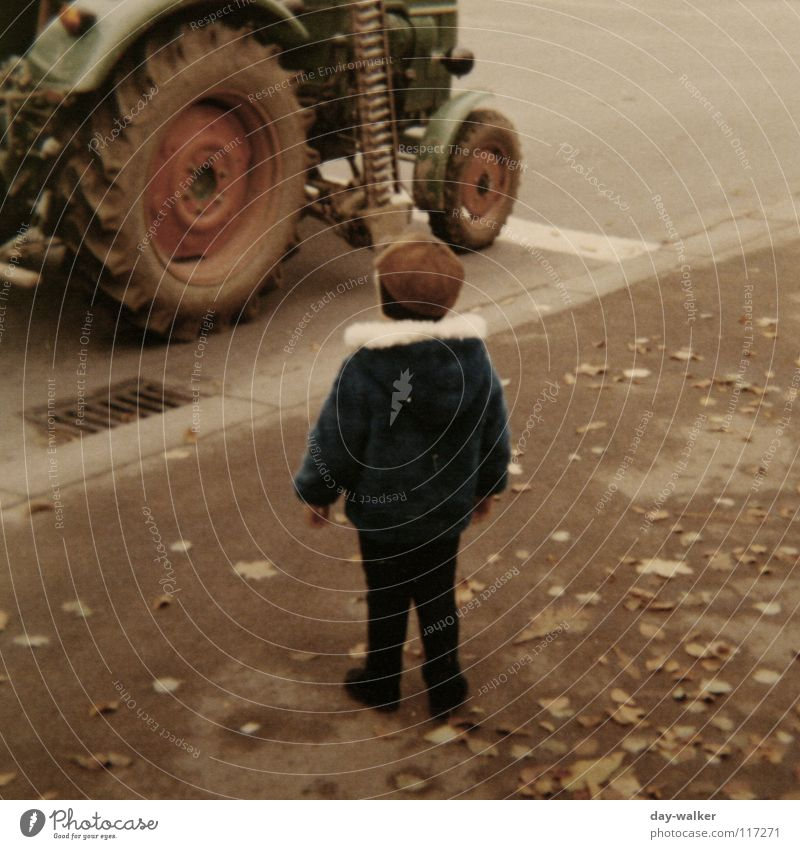Man and Technology Child Boy (child) Tractor Seventies Machinery Asphalt Leaf Sidewalk Retro Amazed Driving Stand Old Street Wheel Marvel Respect me Walking