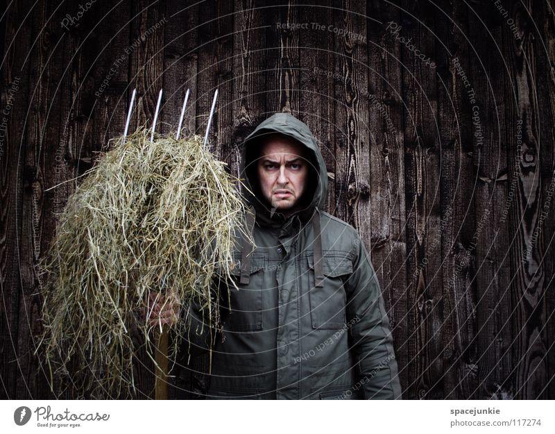 farmer seeks woman Man Portrait photograph Freak Wall (building) Wood Winter Cold Work and employment Cleaning Evil Ferocious Straw Manure heap Pitchfork Farmer