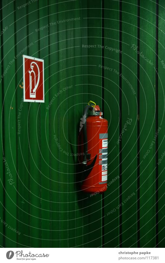 study in red/green or: the same in green Green Extinguisher Fire prevention Wood Panels Wall (building) Lecture hall Pictogram Rescue Erase Safety Dangerous