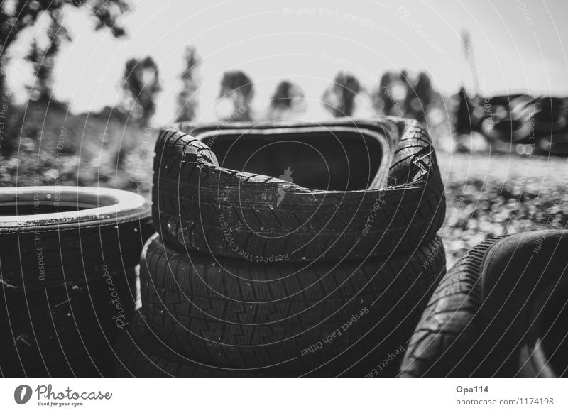 """tire stacks Tire tread Rubber Old Black White Transience """"Tyres Stack Storage Dented dent Broken Profile Black & white photo Exterior shot Close-up Detail"""