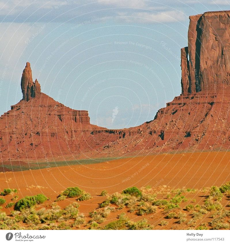 monumental Red Green Tuft of grass Utah Arizona Summer Clouds Multicoloured Desert USA Monument Valley Colour Orange Rock Mountain rock needle Vest