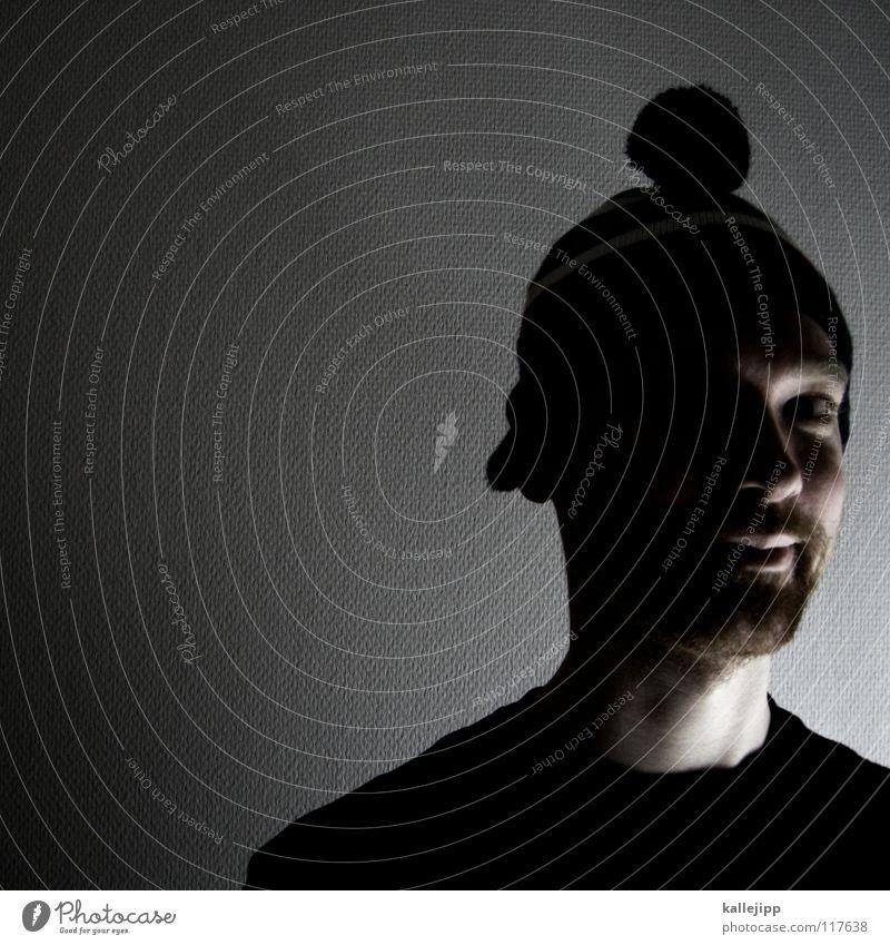 Adults Young man Eerie Nerdy Doofus Designer stubble Goatee Unshaven Woolen hat Detail of face Face of a man