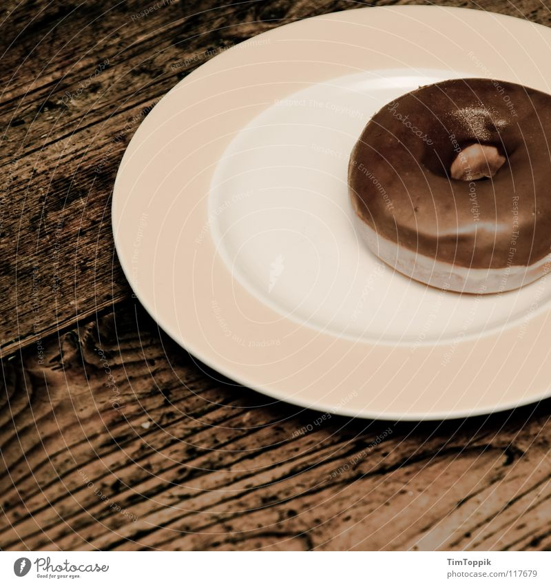 Donutella Table Wooden table Wood grain Texture of wood Kitchen Plate Edge of a plate Round Fat Unhealthy Circle Circular Yeast Baked goods Tartlet Nutrition