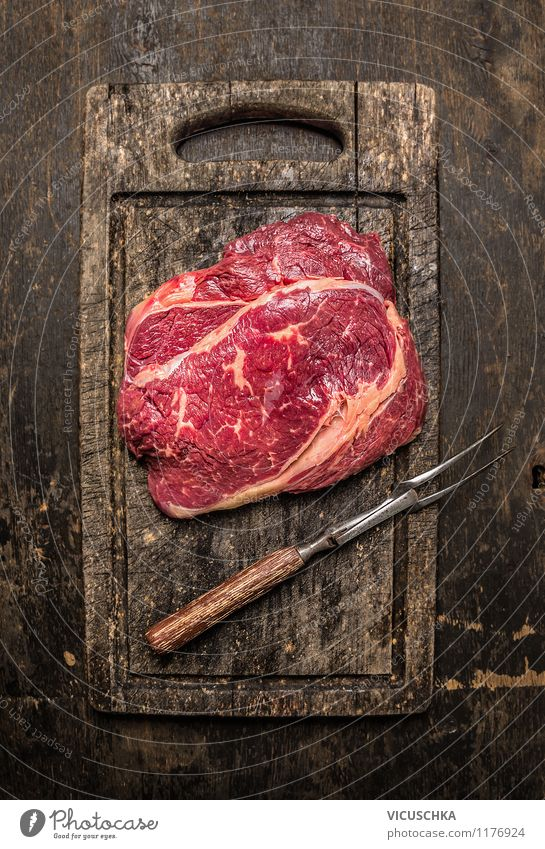 Beef with meat fork on old cutting board Food Meat Nutrition Lunch Dinner Banquet Organic produce Diet Fork Style Design Healthy Eating Table Kitchen Restaurant