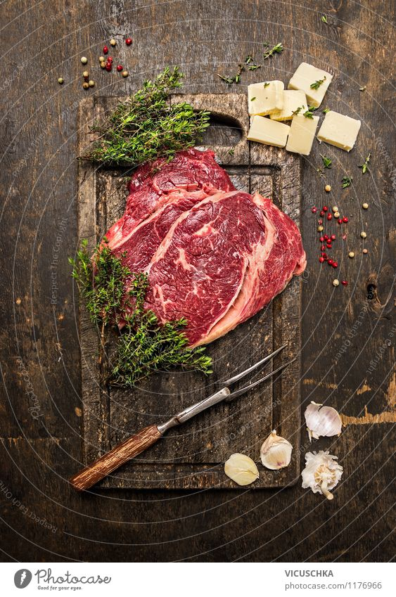 Beef steak with thyme and butter on a rustic table Food Meat Herbs and spices Nutrition Lunch Dinner Organic produce Diet Fork Style Design Healthy Eating Table