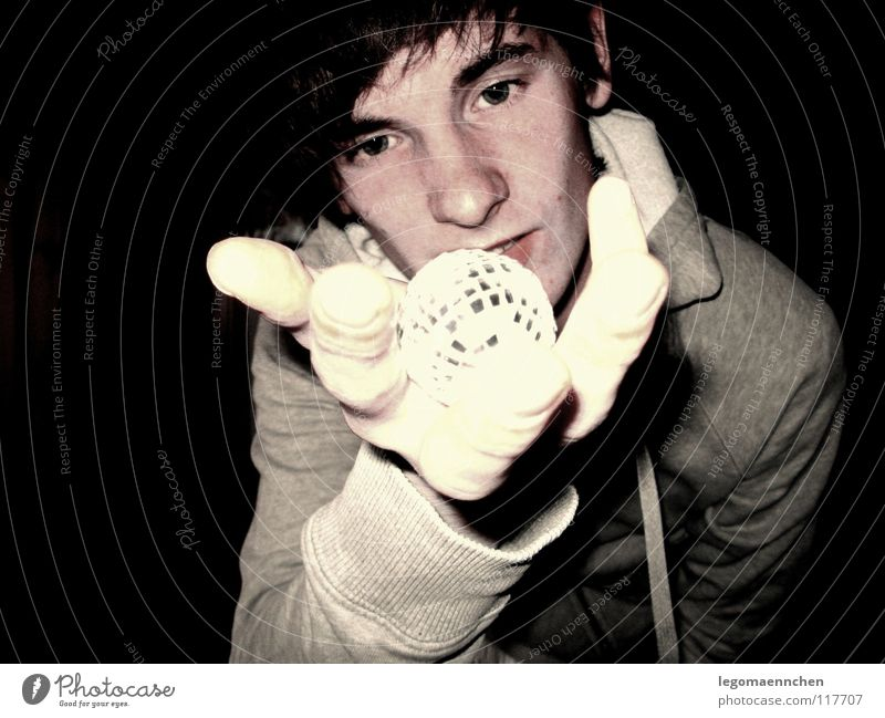 Youth (Young adults) Hand Black Yellow Dark Gray Sphere Alcoholic drinks Amazed Disco ball Yellowness Hooded sweater