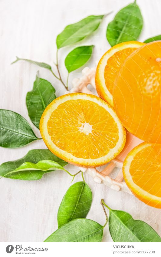 Cut orange with green leaves Food Fruit Orange Dessert Nutrition Organic produce Vegetarian diet Diet Juice Style Design Healthy Eating Life Summer Nature