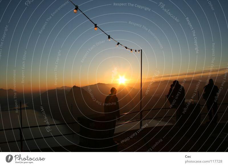 Human being Sky Sun Blue Winter Loneliness Dark Mountain Dream Lake Gold Hope Future Switzerland Electric bulb Dusk