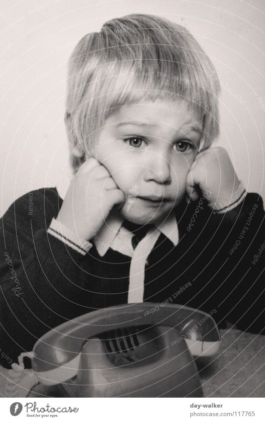 She's not calling. Child Telephone Boy (child) Blonde Jacket Exasperated To call someone (telephone) Retro Toys Hair and hairstyles Boredom Old Sadness