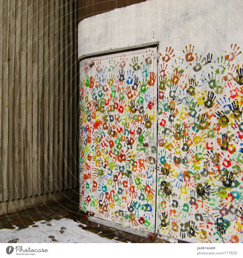 Design wall with many colourful hands Hand Snow door Decoration Many Environment Participation Difference Corner Imprint Teamwork Street art Multicoloured