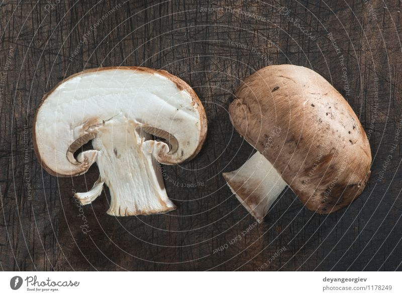 Sliced mushrooms on wooden table Vegetable Nutrition Dinner Vegetarian diet Diet Table Cook Nature Fresh Delicious Natural Brown White Mushroom food healthy