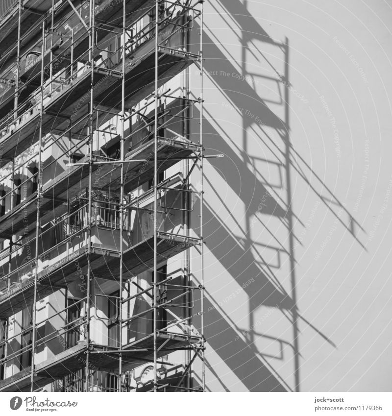 Shadow at work Construction site Prenzlauer Berg Town house (City: Block of flats) Facade Fire wall Scaffold Line Build Authentic Sharp-edged Large Long Above
