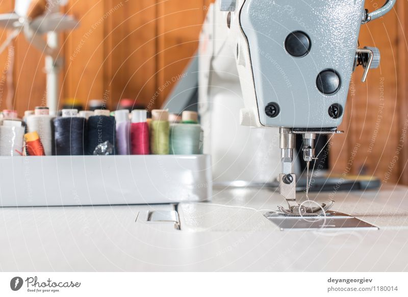 Woman sewing on a sewing machine Design Leisure and hobbies Work and employment Profession Factory Industry Craft (trade) Human being Adults Fashion Clothing