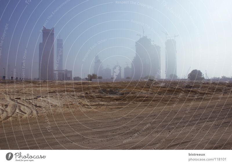 Escape Tower Dubai United Arab Emirates Construction site Fog Business Bay Sand Morning Desert Sun Burj Dubai Falcon Tower executive towers Dubai Holding enamel