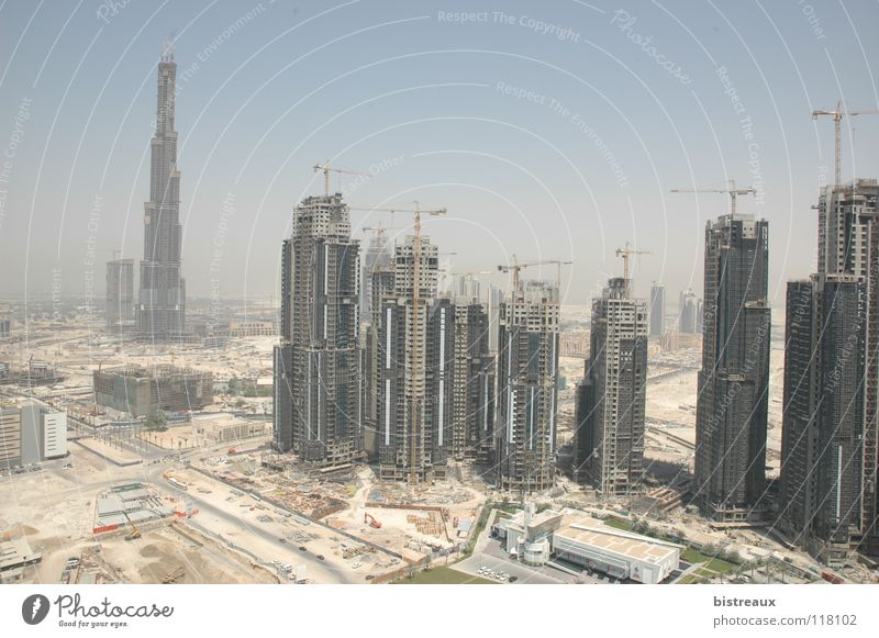 Sand High-rise Construction site Desert Crane Dubai Morning United Arab Emirates