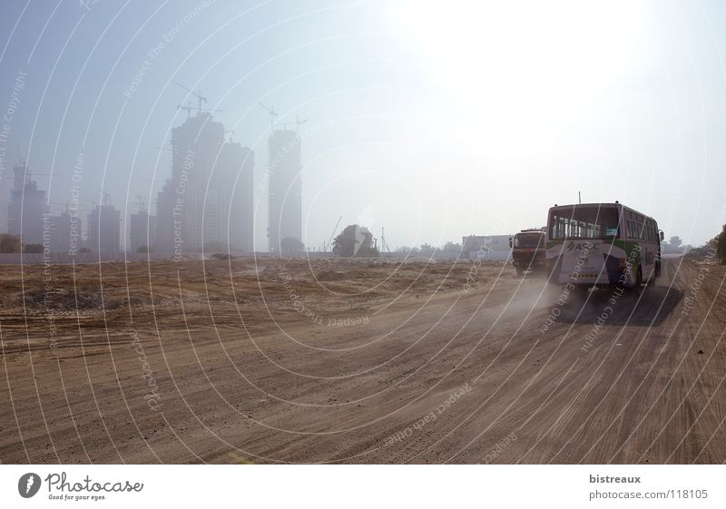 Sun Sand High-rise Construction site Desert Bus Crane Dust Dubai Asia United Arab Emirates