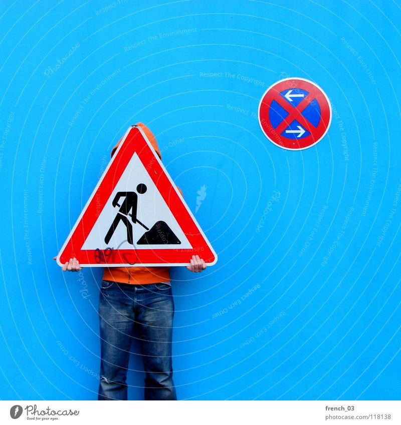 road sign stuff Human being Man Blue Hand White Beautiful Red Colour Wall (building) Wall (barrier) Orange Germany Work and employment Arm Signs and labeling