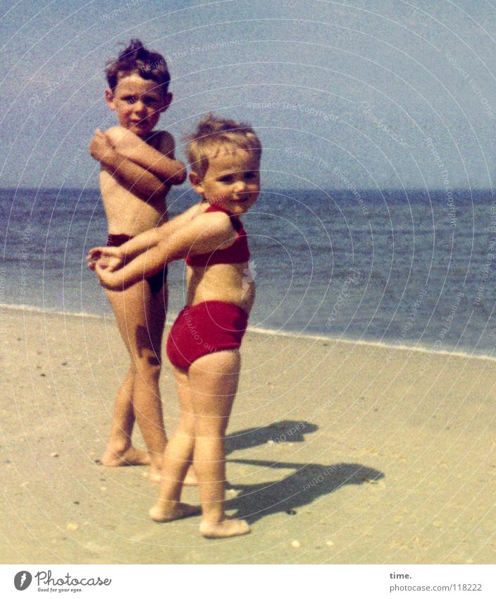 Decisiveness at 13° water temperature Vacation & Travel Summer Summer vacation Sunbathing Beach Ocean Girl Boy (child) Brother Sister 2 Human being Sand Water