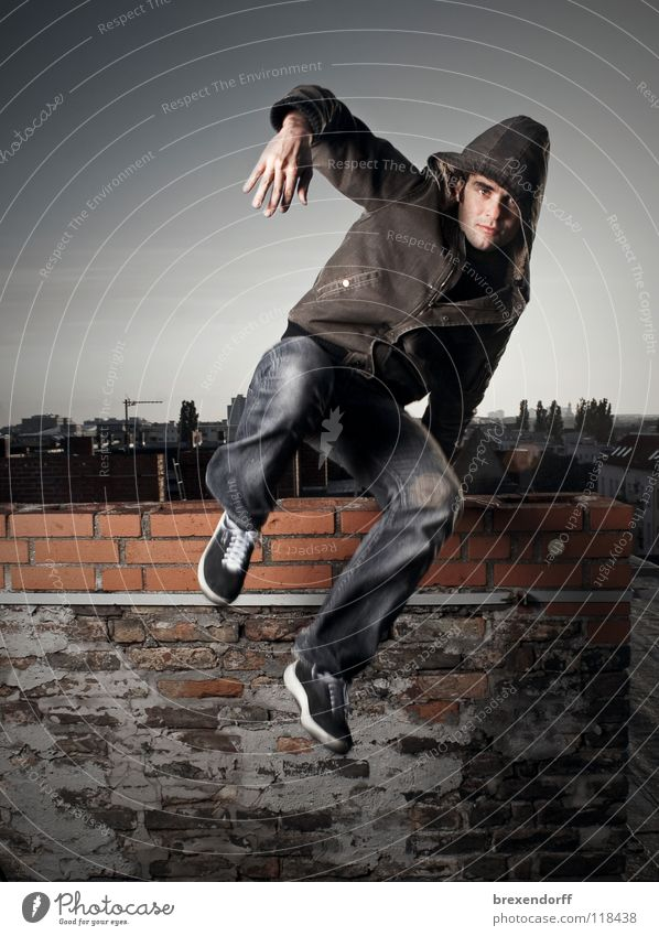 Man Youth (Young adults) Jump Running Dangerous Roof Leisure and hobbies To fall Escape Chimney Hop Flee