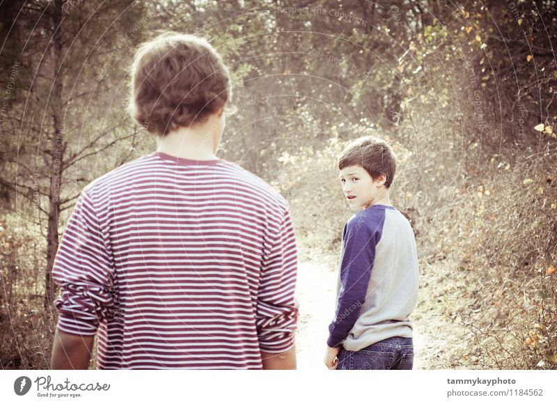 Younger brother looking back at older brother Lifestyle Human being Masculine 2 8 - 13 years Child Infancy 13 - 18 years Youth (Young adults) Nature Walking