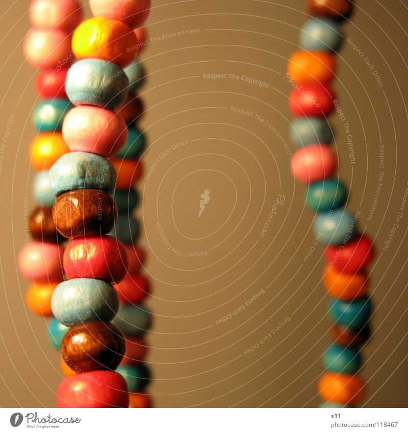 ornament Beautiful Decoration Jewellery Wood Blue Brown Pink Pearl necklace Wooden bead Neck Chain Orange distortion Close-up Macro (Extreme close-up)