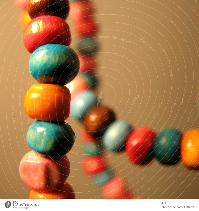 Jewellery. Luxury Beautiful Wood Blue Brown Pink Pearl necklace Wooden bead Neck Chain Orange distortion Close-up Macro (Extreme close-up)