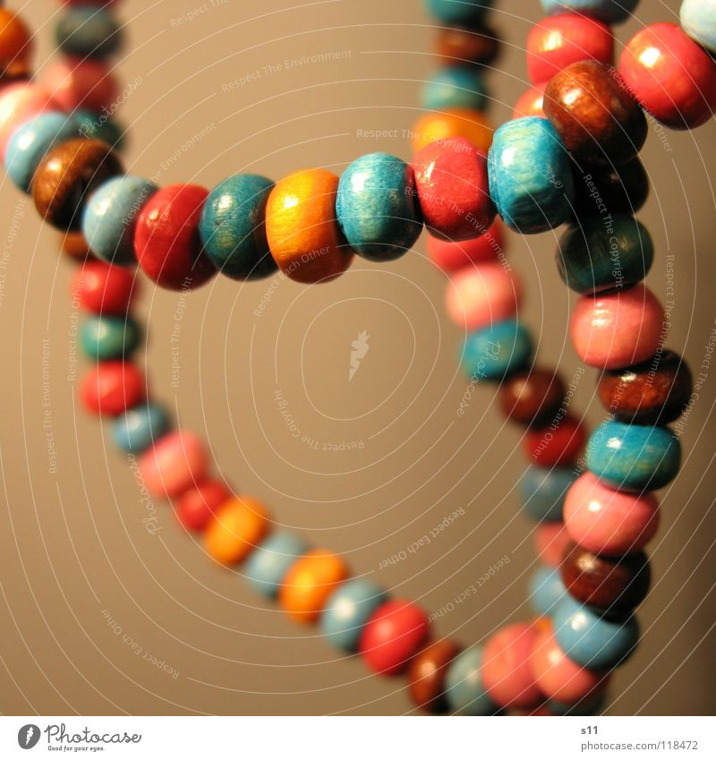 Jewellery. Luxury Decoration Wood Blue Brown Pink Pearl necklace Wooden bead Neck Chain Orange distortion Close-up Macro (Extreme close-up)