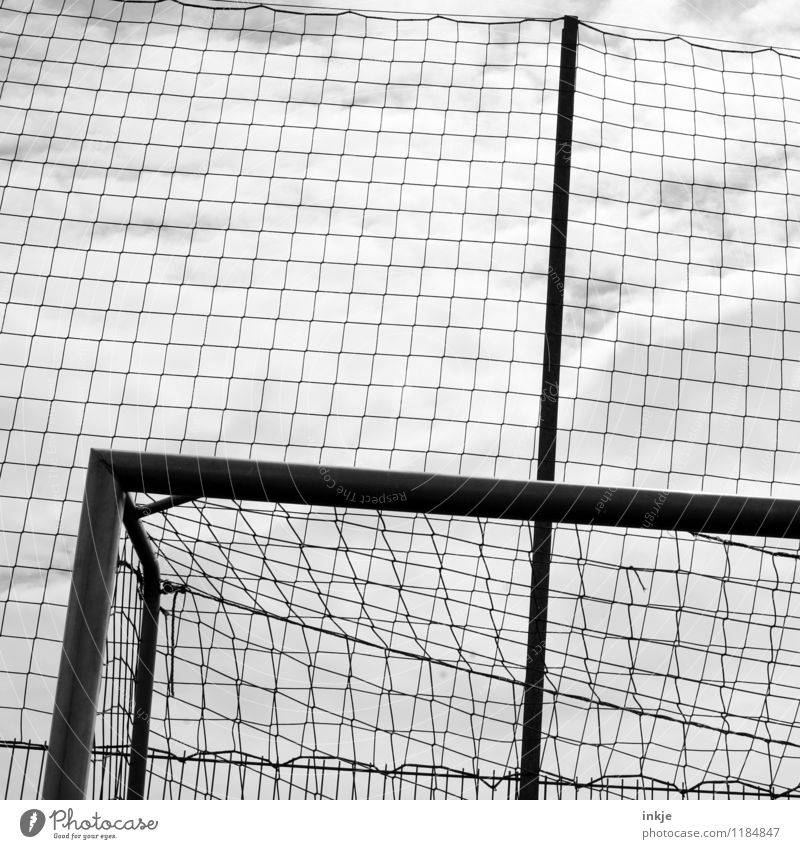 Goal! Leisure and hobbies Sports Soccer Goal Net Football pitch Line Superimposed Dark Grid Black & white photo Exterior shot Close-up Detail Pattern Deserted