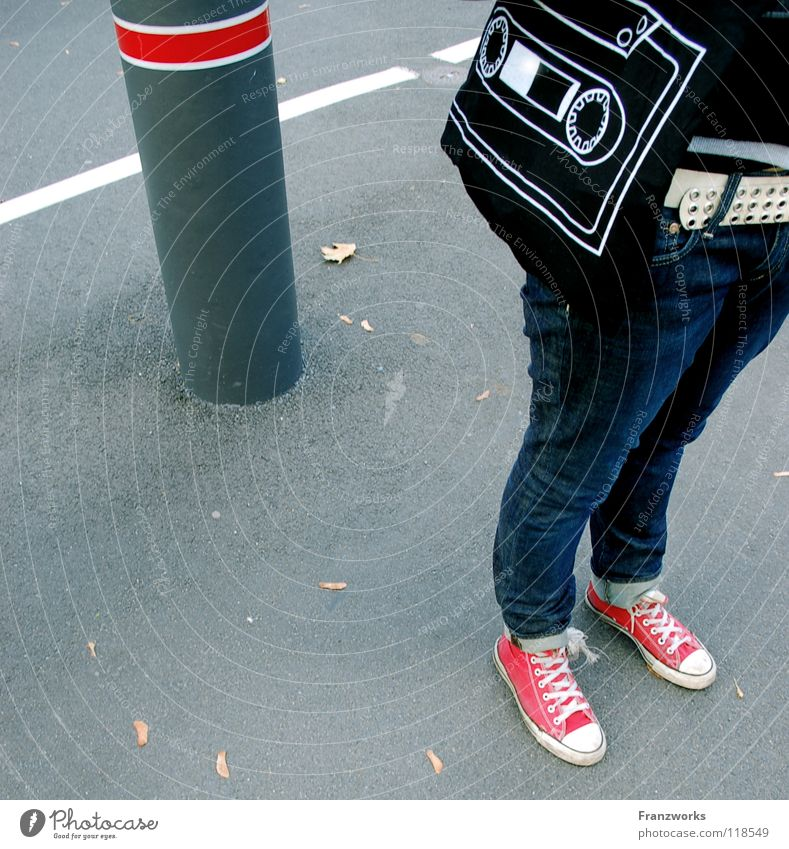 Sound carrier. Asphalt Chucks Column Leaf Belt Tape cassette Bag Transport Sneakers Generation Autumn Leipzig Graphic Traffic infrastructure Street Jeans Legs