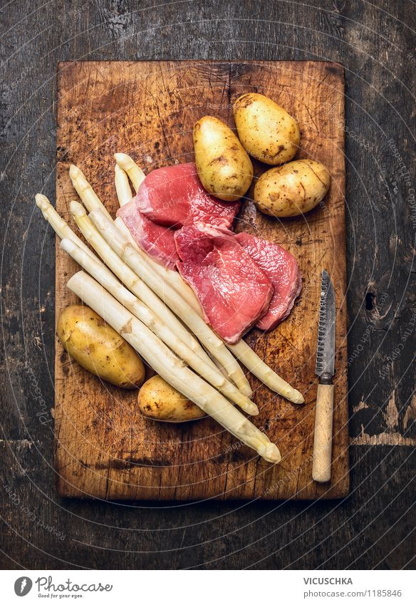 Asparagus, schnitzel, potatoes - classic cooking. Food Meat Vegetable Nutrition Lunch Dinner Banquet Organic produce Diet Knives Lifestyle Style Design