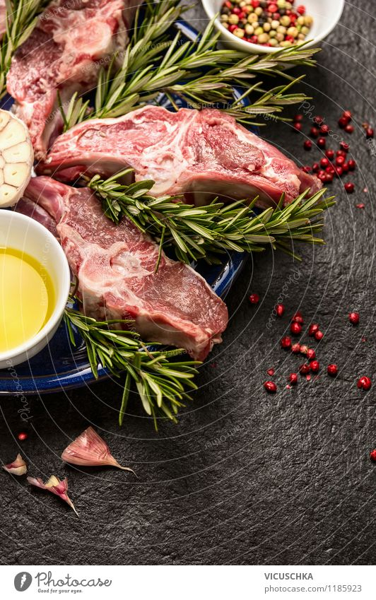Fresh lamb cutlet with garlic, rosemary and oil Food Herbs and spices Cooking oil Nutrition Lunch Dinner Banquet Organic produce Bowl Style Healthy Eating Life