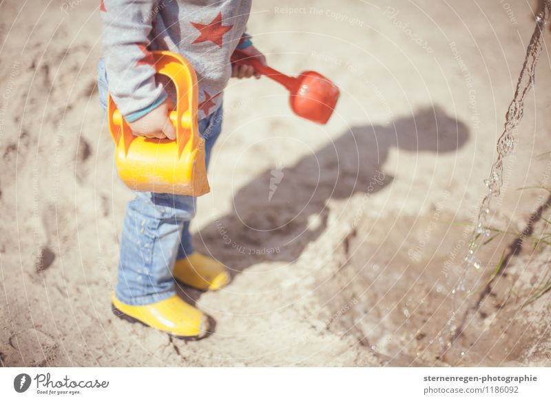 Human being Child Water Girl Adults Boy (child) Playing Sand Infancy Star (Symbol) Childhood memory Toddler Parents Kindergarten Playground Rubber boots